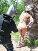 Captured viking chick gets her tight butt hole fisted rough by perverted knight.