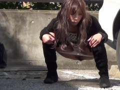 Milfs pissing next to the car